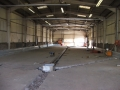 Installation of stainless drains in warehouse conversion